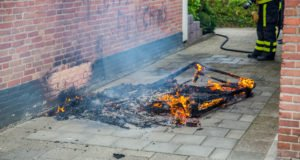 Bank in brand aan Coornhertlaan in Roosendaal